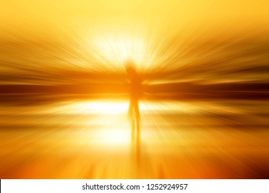 An abstract human figure zoom in at the beach during glowing golden sunset.