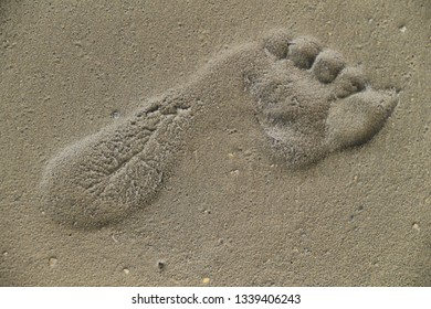 Abstract human footprint in sand