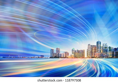Abstract Illustration of an urban highway going to the modern city downtown at sunset or sunrise with colorful light trails.