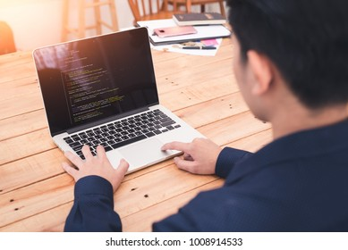 The abstract image of the asian programer developing the software by the desktop computer. The concept of coding, programing, developing, software, education and technology.
