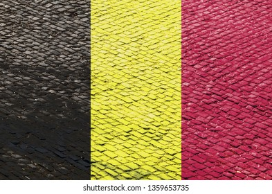 Abstract image of a Belgian flag blended with a real cobblestone road pattern. Image related to the famous French road cycling races on the cobblestone roads (Tour of Flandres).