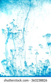 Abstract image of blue ink in water.
