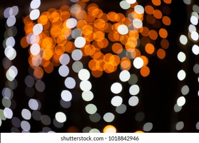 Abstract image of blurred fairy lights against a dark background