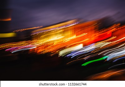 Abstract image of blurred illumination and night lights New York City. Intentional motion blur