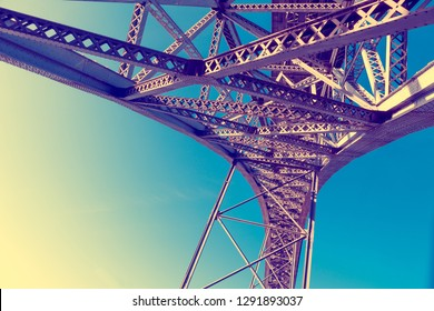 Abstract image of bridge metal structure in perspective.Modern iron bridge detail against blue sky