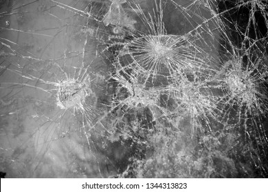 Abstract image of broken glass texture, background. Close-up broken car windshield. Broken and damaged car