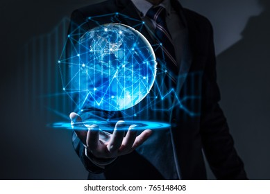 The abstract image of the business man hold the virtual hologram on hand and element of this image furnished by Nasa. the concept of communication network, internet of things and future life