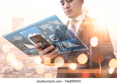 The abstract image of business man point to the hologram on his smartphone and blurred cityscape is backdrop. the concept of communication network, cyber security, internet of things and future life.