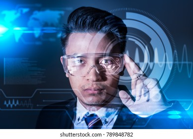 The abstract image of business man using a smart glasses or vr glasses overlay with virtual hologram image. the concept of communication, internet of things and future life.