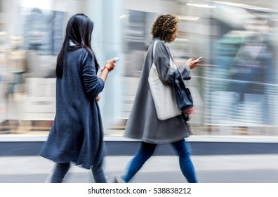 abstract image of business people with mobile phone in the street with  blurred background