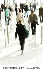 Abstract image of a business people rushing in the lobby in intentional motion blur
