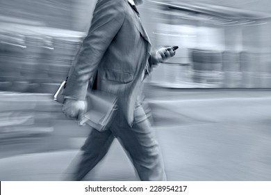 abstract image of business people in the street and modern style with a blurred background and blue tonality
