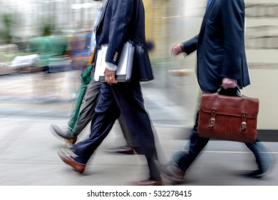 abstract image of business people in the street and modern style with a blurred background