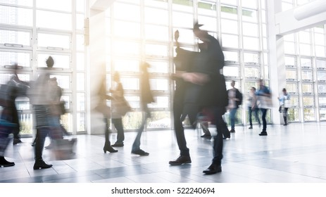 Abstract Image of Business People Walking at a floor