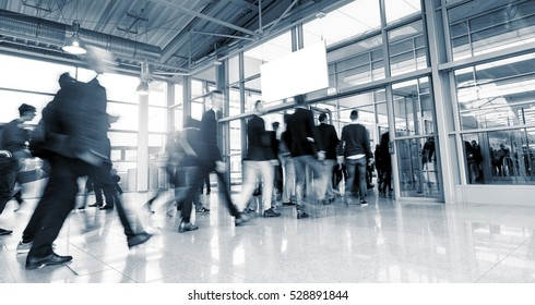 Abstract Image of Business People Walking at a International Trade Fair