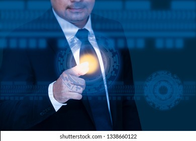 The abstract image of Business person working with modern virtual technology point to the hologram. Concept of communication, business, financial and internet of things and technology