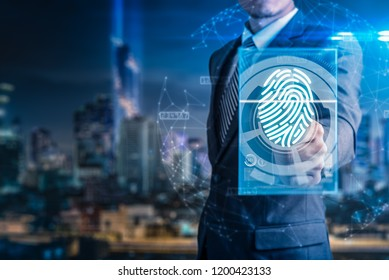 The abstract image of the businessman use a thumb scanning during sun shining. the concept of fingerprint, biometric, information technology and cyber security.