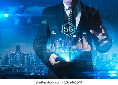 The abstract image of businessman using a smartphone overlay with 5g and cityscape hologram. the concept of 5G, communication, network, connection, internet of things.