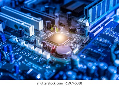 The abstract image of the chipset on the computer mainboard. The concept of computer hardware upgrade and technology