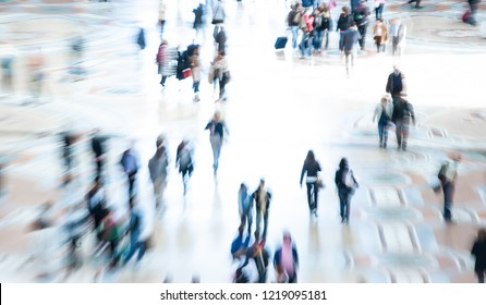 Abstract image of city commuters. High key intentional blur of crowd of unrecognizable people walking in the city. Bleached effect. Concept for business, shopping, modern life, corporate, future