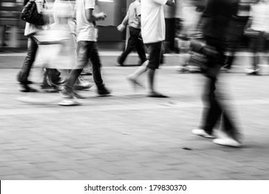 abstract image of city people rushing on the street blurred motion,black and white