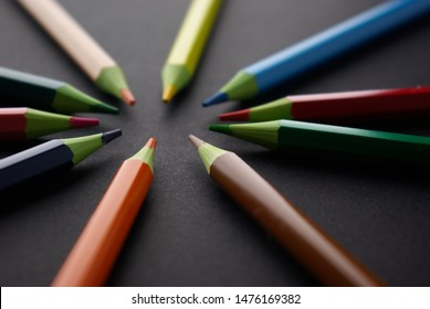 abstract image of color pencils on a black background
