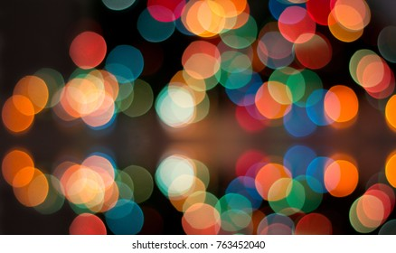 Abstract image of colorful sparkle lights blurred in background. Christmas holiday or party concept