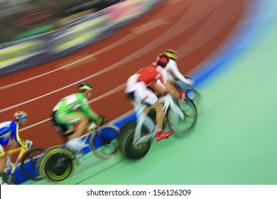 abstract image of cyclists running