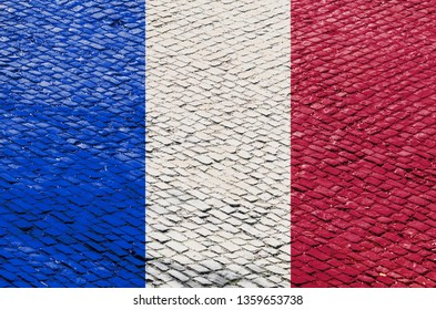 Abstract image of a French flag blended with a real cobblestone road pattern. Image related to the famous French road cycling races on the cobblestone roads (Paris-Roubaix).