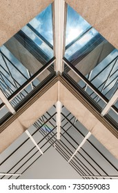 Abstract image of glass and concrete building. Architectural exterior facade and detail. Abstract color background. Modern architecture and design.