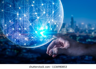 The abstract image of the hand point to the global network virtual hologram and element of this image furnished by Nasa. the concept of communication network, internet of things and future life
