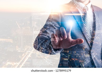 The abstract image of the hand point to the global network virtual hologram. the concept of communication network, internet of things and future life