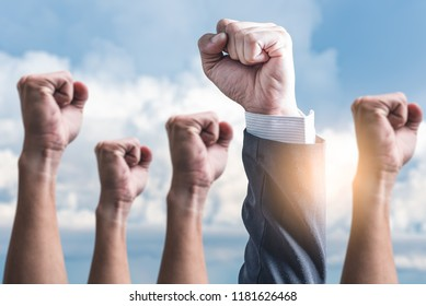 the abstract image of the hands rising up to the sky. the concept of teamwork, successful, rising and power.