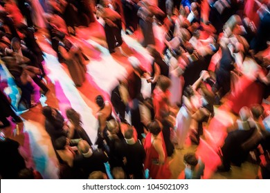 Abstract image of a large group of people dancing at a ball. Intentional motion blur