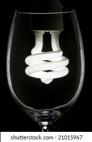 An abstract image of a light bulb in a wine glass