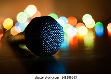 Abstract image of microphone with lights in background. Macro with extremely shallow dof.