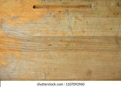 An abstract image of an old wooden desk top.