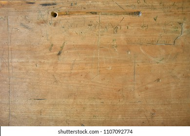 An Abstract Image Of An Old Wooden School Desk Top.