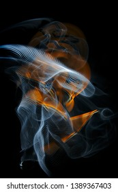 The abstract image painted by moving light, moving objects and twisted ordered parallel lines  on a black background. Color abstraction.