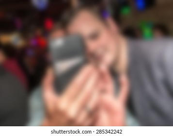 Abstract image of people taking selfie at party