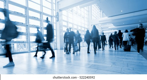 Abstract Image of People Walking at a traid fair floor