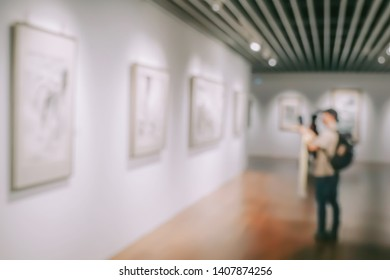 Abstract image of people watching photograph or Image in art gallery museum, abstract blur or defocus background