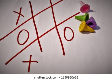 abstract image of playthings on a tictactoe page