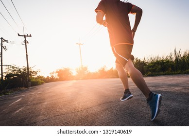 the abstract image of the runner running on the countryside road in the morning. the concept of healthy, running, energy and future.