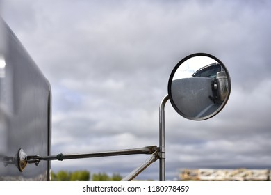 An abstract image of a semi truck side mirror.