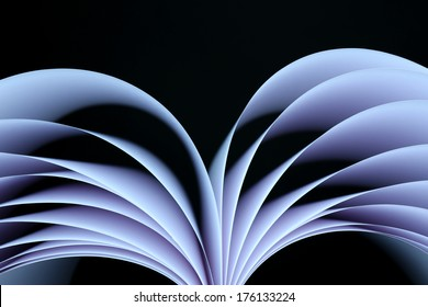 Abstract image of sheets white paper wave shape on black background close-up