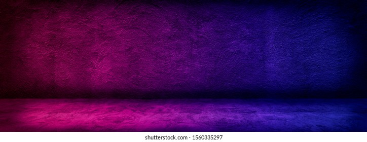 Abstract image of Studio dark room with lighting effect red and blue on concrete wall gradient background for interior decoration.