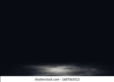 Abstract image of Studio dark room concrete floor texture background.