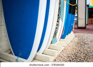 abstract image of surfboards for rent lined up in front of a store on Kauai, Hawaii