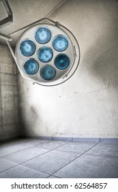 An abstract image of a surgical lamp at an abandoned hospital